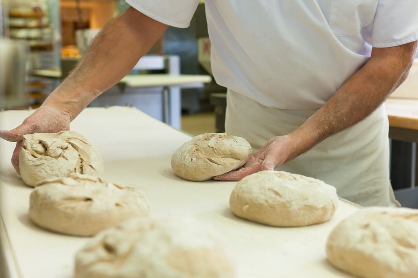baker with fresh bread dough