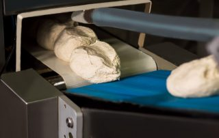 dough on the conveyor belt